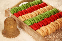 Red and green macaroons on wooden plate Royalty Free Stock Photos
