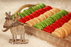 Red and green macaroons on wooden plate Royalty Free Stock Photo
