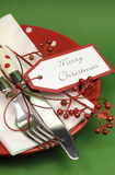 Red and green Merry Christmas dinner table place setting - vertical closeup Stock Photo