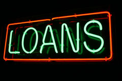 Red and Green Neon Loan Sign. Red and Green Neon Sign lights up the night Stock Photography