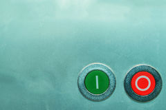 Red and green on and off buttons on metal surface Stock Photography