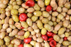 Red and green olives background Stock Image