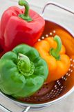 Red, green and orange bell peppers Royalty Free Stock Images