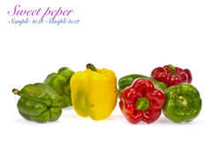 Red green and orange sweet bell peppers Royalty Free Stock Images