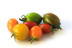 Red, green, orange and yellow tomatoes isolated on white. Red, green, orange and yellow tomatoes isolated on white background Stock Image