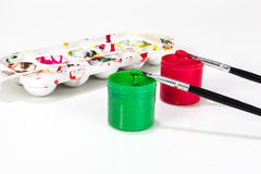 Red and green paint boxes with brushes Royalty Free Stock Photo