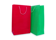 Red and green paper shopping bags isolated Stock Photos