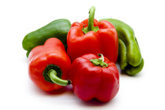 Red and green paprika. On white background Stock Image