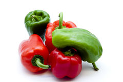 Red and green paprika. On white background Stock Photo