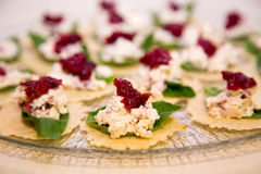 Red and green party snacks on a glass plate Stock Images