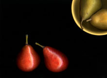 Red and Green Pears on Black Royalty Free Stock Photo