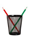 Red and green pencils in black pencil holder Royalty Free Stock Photo
