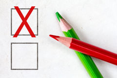 Red and green pencils with marking checkbox Royalty Free Stock Photos