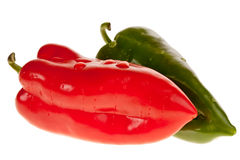 Red green pepper. Close-up of a red and a green pepper isolated on white royalty free stock photo