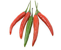 Red and green pepper. Green pepper chili lies between red  pepper Stock Photography