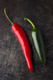 Red and green pepper. On a dark background in studio Stock Photos
