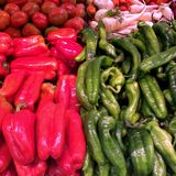 Red and green pepper. Red and green fresh peppers on market tray Royalty Free Stock Photography