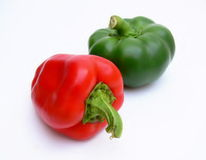 Red and green peppers. On the white background Stock Images