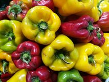 Red and Green peppers at farmers market Stock Photo