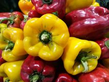 Red and Green peppers at farmers market Stock Photos