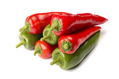 Red and green peppers isolated on white background stock image