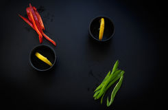 Red and green peppers and lemon. Low key natural lighting.  royalty free stock photography