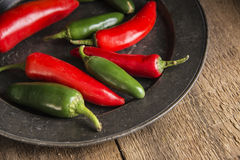 Red and green peppers in vintage retro moody natural lighting se Stock Image