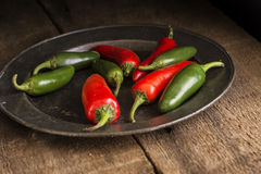 Red and green peppers in vintage retro moody natural lighting se Stock Photos