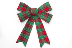 Red and green plaid holiday bow. On white background Royalty Free Stock Photos