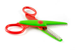 Red and green plastic scissors Royalty Free Stock Photos