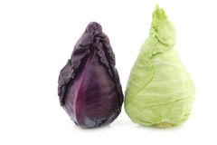 A red and a green pointed cabbage. On a white background royalty free stock photos