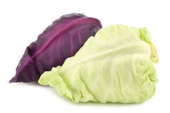 A red and a green pointed cabbage. On a white background stock photo