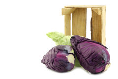 Red and green pointed cabbage in a wooden crate Royalty Free Stock Photos