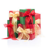 Red, green presents in a studio setting. Over white stock photo