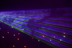 Red, green, purple, white, pink, blue laser lights cutting through smoke machine smoke. In a gay nightclub in Australia stock photo