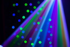 Red, green, purple, white, pink, blue laser lights cutting through smoke machine smoke. In a gay nightclub in Australia with bokeh royalty free stock image