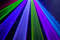 Red, green, purple, white, pink, blue laser lights cutting through smoke machine smoke. In a gay nightclub in Australia royalty free stock images