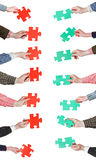 Red and green puzzle pieces in people hands Royalty Free Stock Images