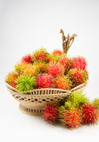 Red and green rambutan on basket. Royalty Free Stock Photos