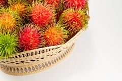 Red and green rambutan in basket. Royalty Free Stock Photos