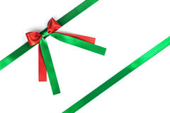 Red and green ribbon bow on white Stock Photography