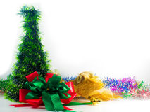 Red and green ribbon with rainbow line against christmas on white Royalty Free Stock Photos