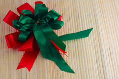Red and green ribbon on wood background. merry christmas festival Stock Images