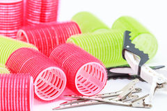 Red and green roll of hair and iron grip Stock Images