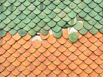 Red and green roof tiles. Red and green broken roof tiles Stock Photo