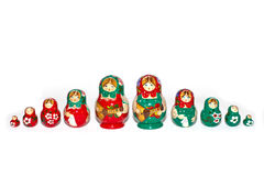 Red and Green Russian Dolls in Single Row Stock Photos