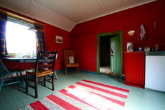 Red and green rustic interior. Rustic interior in a wooden chalet of the lofoten islands Royalty Free Stock Image