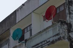 Satellite dish is attached to the balcony. stock image