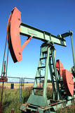 Red and green small crude well Royalty Free Stock Image