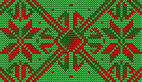 Red and green snowflake knitted background Royalty Free Stock Image